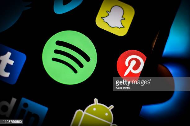 A Spotify logo is seen on an iPhone screen in this photo illustration in Warsaw Poland on March 5 2019