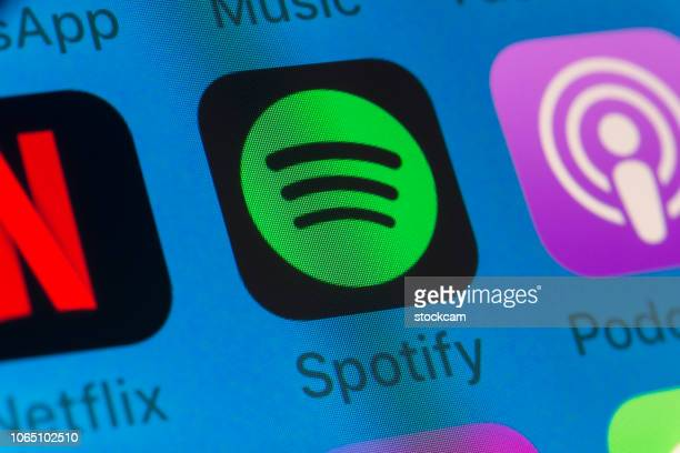 spotify, podcasts, netflix and other cellphone apps on iphone screen - spotify stock pictures, royalty-free photos & images