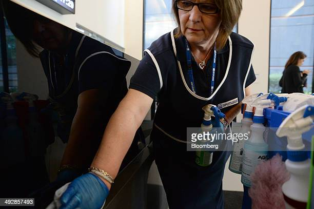 A Spotless Group Ltd employee cleans the reception desk at the company's headquarters in Melbourne Australia on Wednesday May 21 2014 Spotless the...