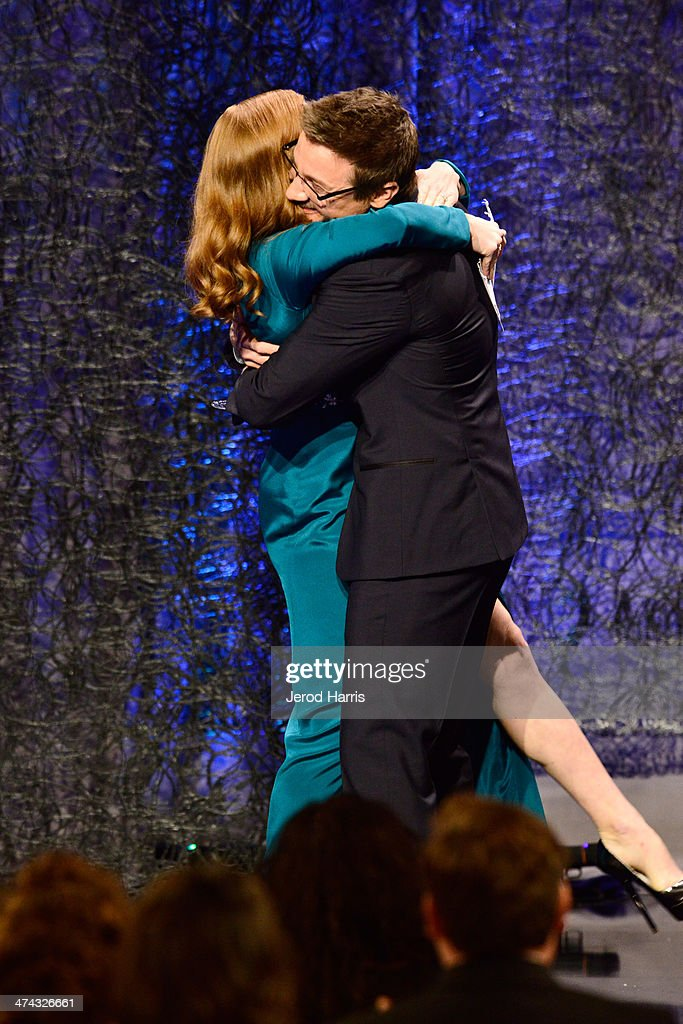 Spotlight Award Honoree Amy Adams and actor Jeremy Renner speak onstage during the 16th Costume Designers Guild Awards with presenting sponsor Lacoste at The Beverly Hilton Hotel on February 22, 2014 in Beverly Hills, California.