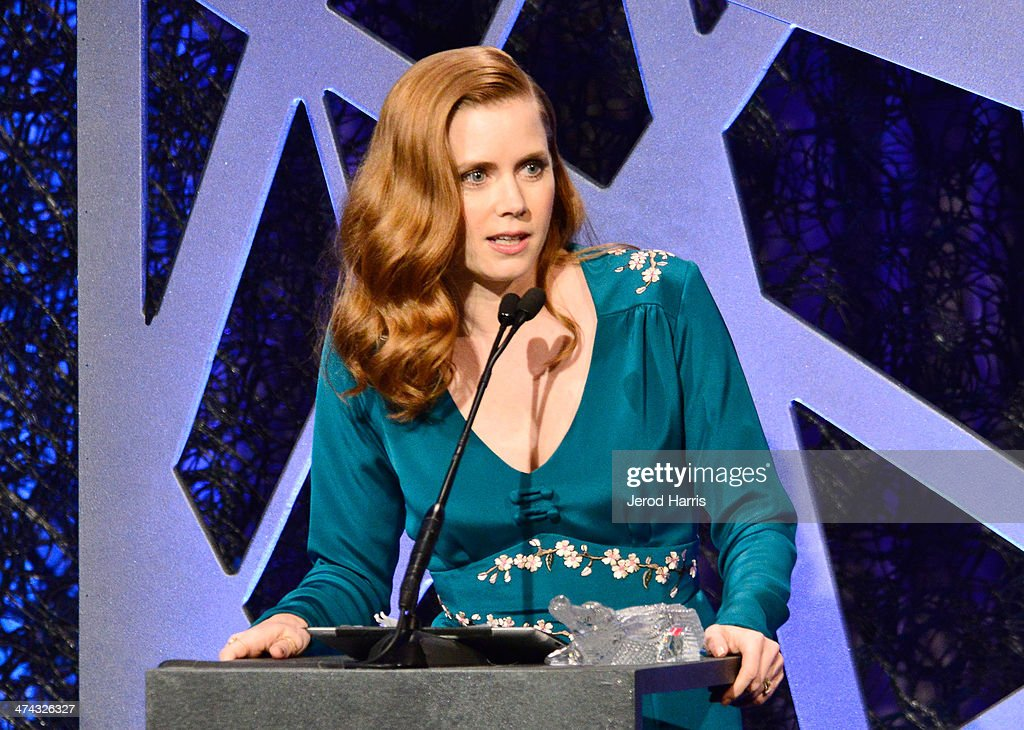 Spotlight Award Honoree Amy Adams speaks onstage during the 16th Costume Designers Guild Awards with presenting sponsor Lacoste at The Beverly Hilton Hotel on February 22, 2014 in Beverly Hills, California.