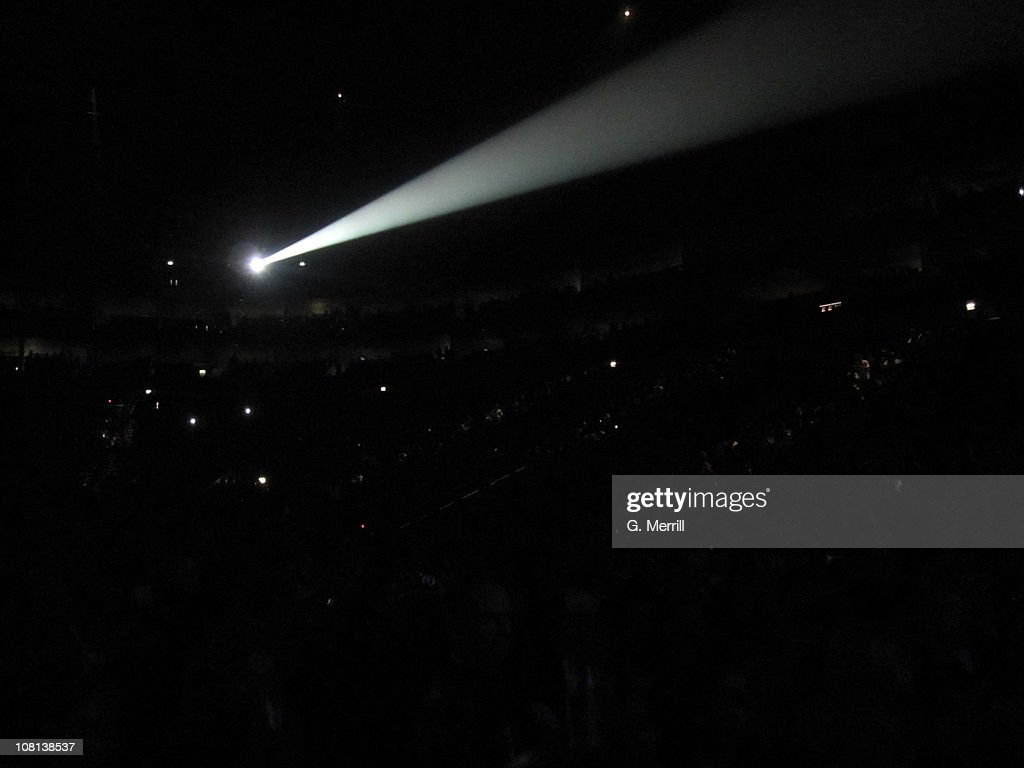Spotlight in front of massive crowd : Stock Photo