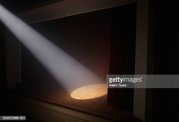 spotlight on empty stage - spotlit stock pictures, royalty-free photos & images