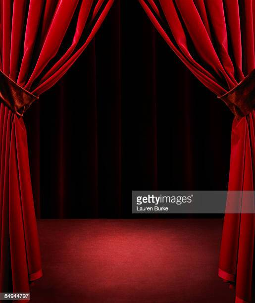 Spotlight on Empty Stage with Red Velvet Curtains