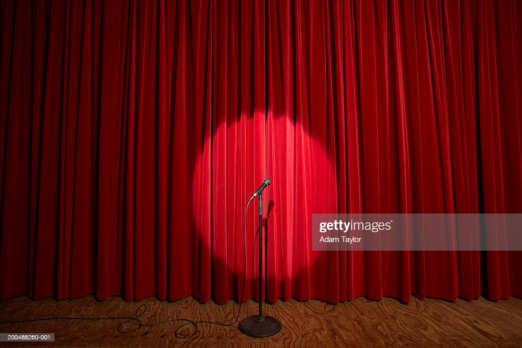 Spotlight on microphone stand on stage : Stock Photo