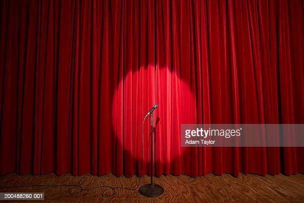 spotlight on microphone stand on stage - spotlit stock pictures, royalty-free photos & images