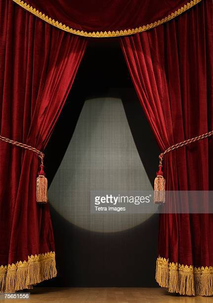 spotlight on open stage curtains - stage curtain stock pictures, royalty-free photos & images