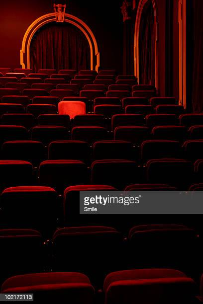 Spotlight on single seat in theatre