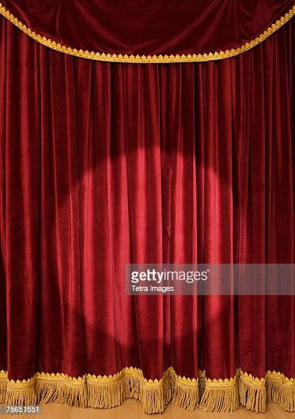 spotlight on stage curtain - stage curtain stock pictures, royalty-free photos & images