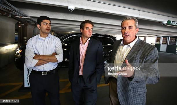 SpotLight Parking CTO Karan Singhal left and CEO Mike Miele center listen to VPNE president Kevin J Leary Bostonbased parking management company VPNE...