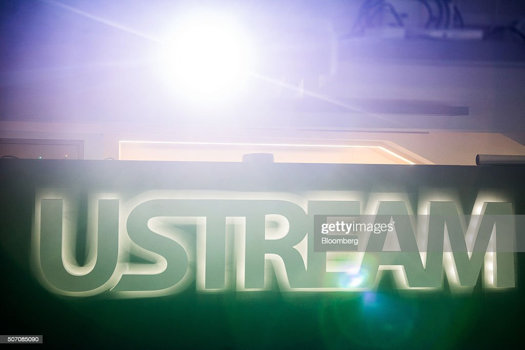 A spotlight sits above an illuminated logo inside the Ustream, Inc. office in Budapest, Hungary, on Tuesday, Jan. 26, 2016. International Business Machines Corporation (IBM) is buying live video stream provider Ustream to help sell more video services to clients including the National Football League, HBO and the Food Network, through its cloud platform. Photographer: Akos Stiller/Bloomberg via Getty Images