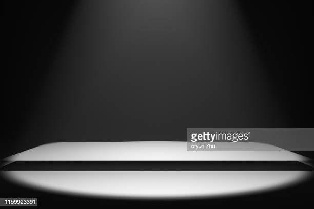 spotlight with empty stall,3d render - winners podium stock pictures, royalty-free photos & images