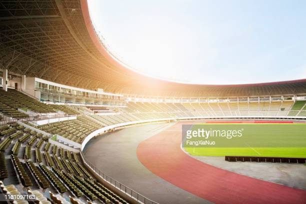 spotlights and floodlights at a stadium - stadium stock pictures, royalty-free photos & images