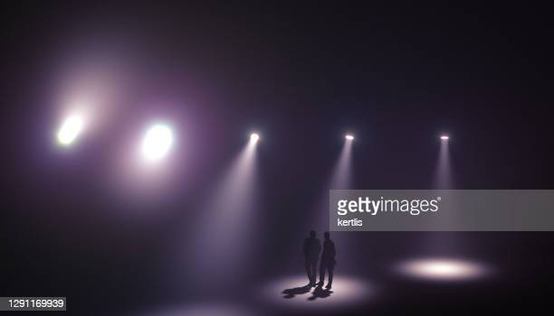 spotlights in the fog - 3d rendering - man blue background stock pictures, royalty-free photos & images