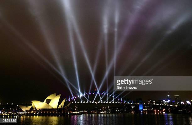 Spotlights on the Sydney Harbour Bridge illuminate the sky over Sydney Harbour during the 'City of Light' display January 7 2004 in Sydney Australia...