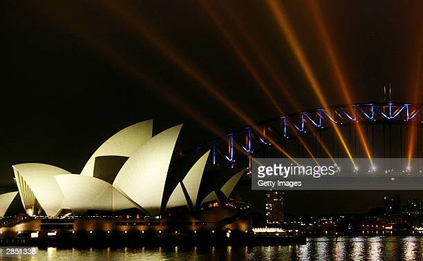 Spotlights on the Sydney Harbour Bridge illuminate the sky over the Opera House on Sydney Harbour during the 'City of Light' display January 7 2004...