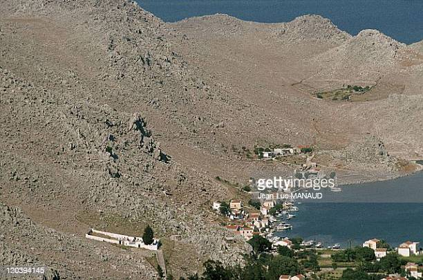 Spots in Mediterranean sea in Symi Greece The small harbour of Pedi is sheltering the very last shipyards