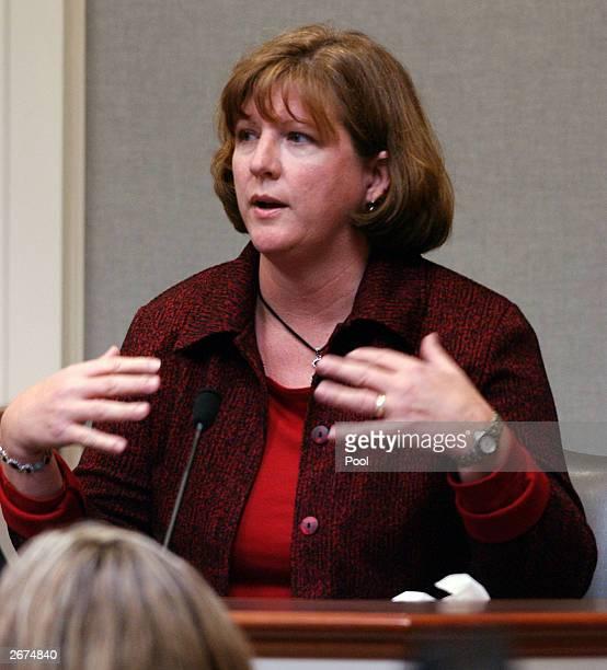 Spotslyvania County sniper victim Caroline Seawell gestures during her testimony at the trial of Washington area sniper suspect John Allen Muhammad...