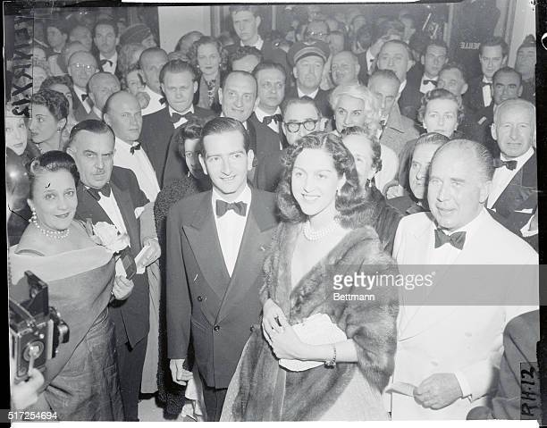 Spotted among first nighters at the 9th International Film Festival opening are exKing Peter II of Yugoslavia and Queen Alexandra who are ardent...