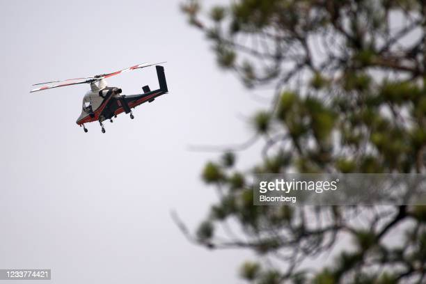 Spotter helicopter flies above a wildfire burning near Lytton, British Columbia, Canada, on Friday, July 2, 2021. Canadian Prime Minister Justin...