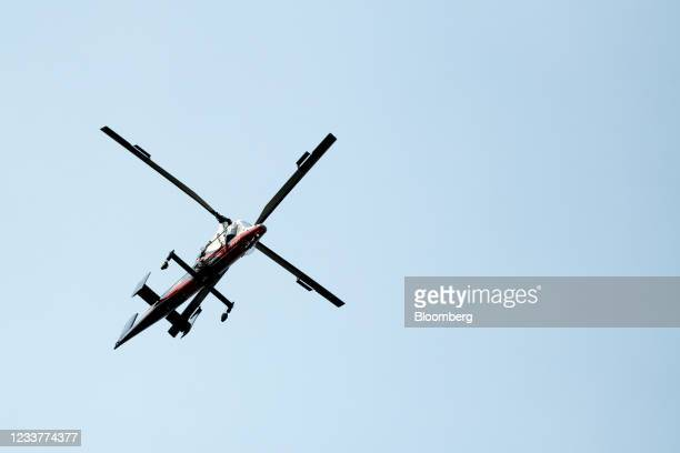 Spotter helicopter searches for wildfires burning near Lytton, British Columbia, Canada, on Friday, July 2, 2021. Canadian Prime Minister Justin...