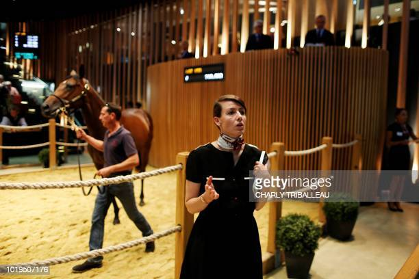 A 'spotter' looks for bidders in the audience as a foal is paraded during the yearlings sales one of the world renowned annual thoroughbred horse...