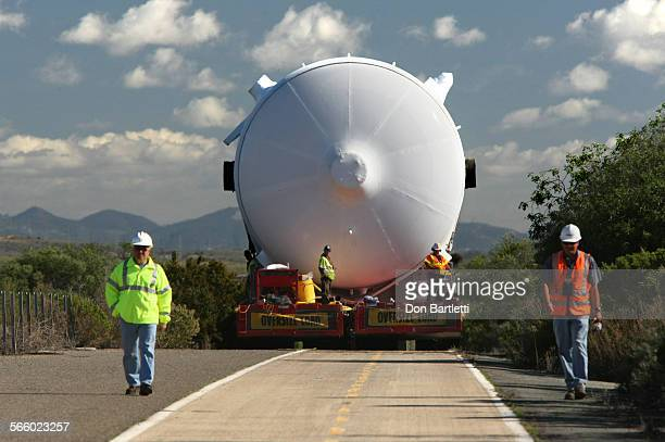PENDLETON CA Spotters and security men walk ahead of the generator on old Highway 101 through San Onofre State Park Emmert International heavy object...
