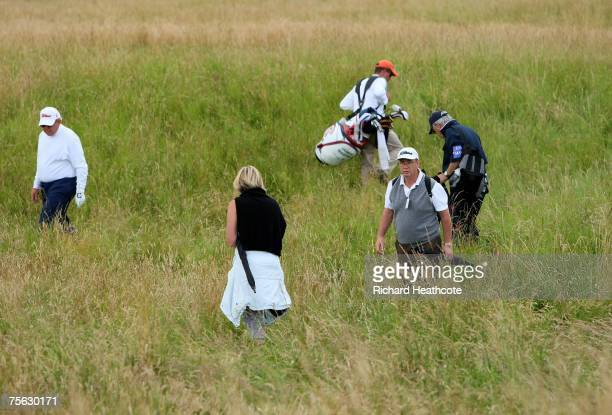 Spotters and spectators fail to find a players ball in deep rough next to the 17th green during practise for The Senior Open Championship 2007 at the...