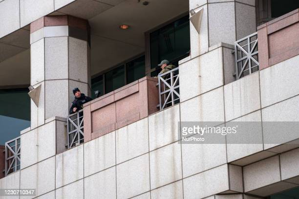 Spotters are seen in a building as members of Antifa march from City Hall to the Ohio Statehouse after President Joe Biden was sworn into office in...