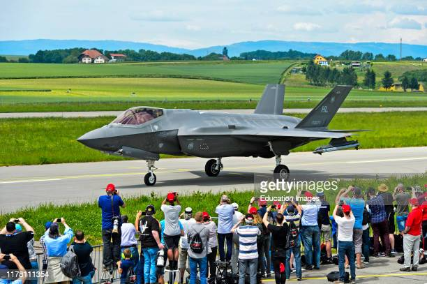 Spotters welcoming the all-weather stealth multirole fighter Lockheed Martin F-35A Lightning II of the US Air Force on the Payerne military airfield...