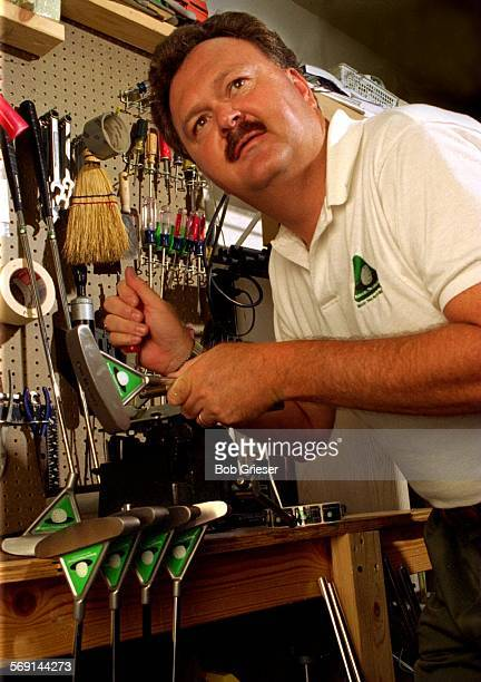 SPPutter/Pritchett1/4BG3Jul96Ronnie S Pritchett in his garage work shop putting the heads of his Bermuda Triangle Putter onto shafts This is his...