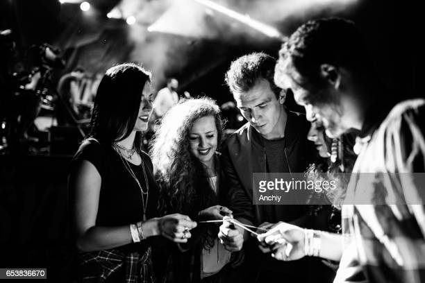 Spraklers glowing, smile on their faces, favorite band playing, let's get this party started. black and white photo