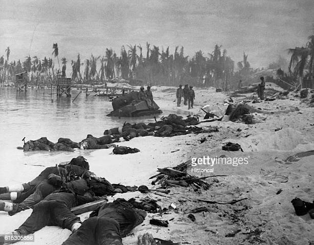 Sprawled bodies on the beach of Tarawa testifying to the ferocity of the struggle for this stretch of sand November 1943