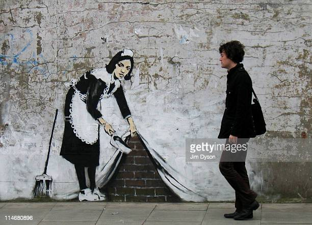 A spray and stencil artwork attributed to guerrilla graffiti artist Banksy appears in Camden on May 16 2006 in London England The striking large...