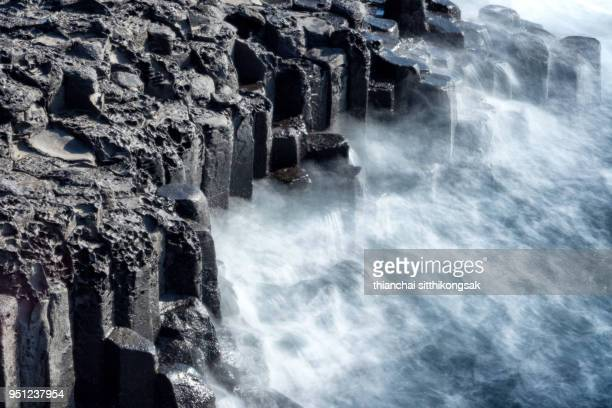 spray of wave impacting coast - jeju island stock pictures, royalty-free photos & images