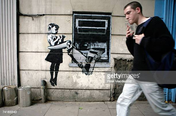 A spray painted depiction of a cash machine grabbing a child adorns a wall in Exmouth Market on May 18 2007 in London