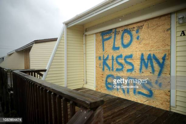 A spray painted message is left on a boarded up condominium as the outer bands of Hurricane Florence being to affect the coast September 13 2018 in...