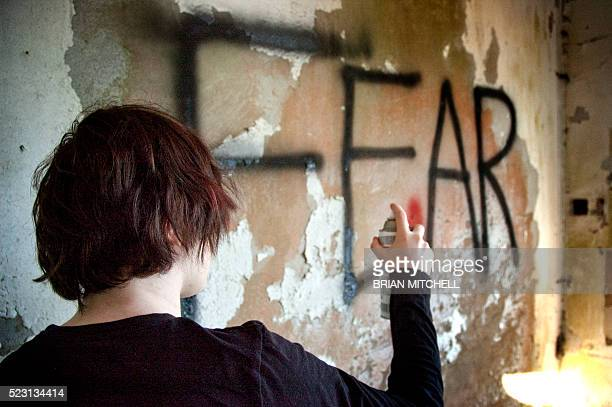 spray painting on a wall - emo stock photos and pictures