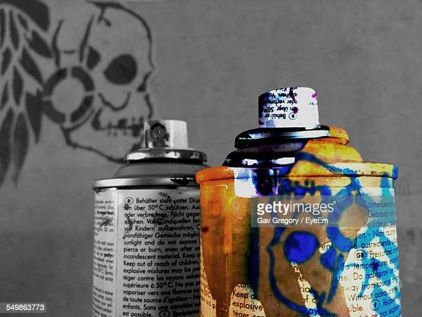 Spray Paints With Danger Sign On Wall
