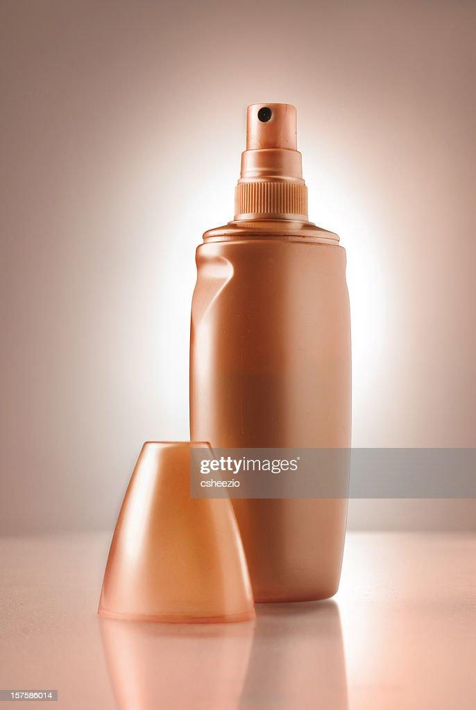 Spray tan bottle : Stock Photo