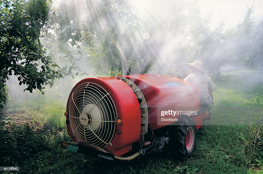 Spraying apples with insecticide,Japan : Stock Photo