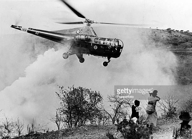 Spraying crops from the air, pic: circa 1940's, A helicopter busy spraying in South Africa, using pesticide to kill insects, seemingly oblivious to...