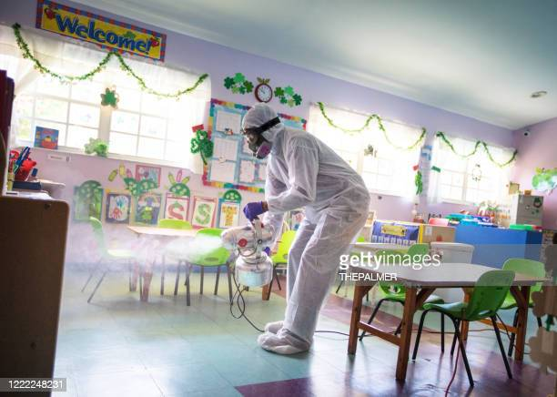 spraying daycare classroom for back to school - clorox stock pictures, royalty-free photos & images