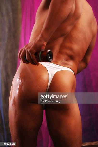 spraying - male bum stock photos and pictures