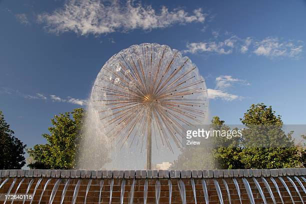 Spraying Spherical Fountain In City Park