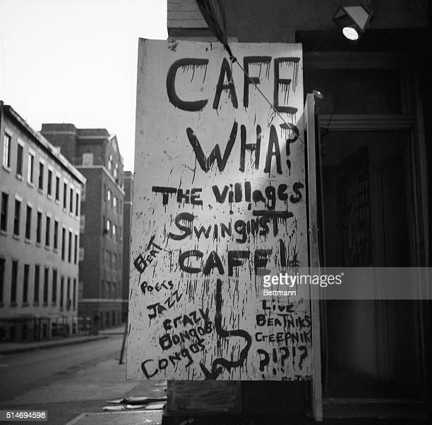 """Spray-painted sign outside Greenwich Village's Cafe Wha? offers """"The Villages Swinginst Cafe!"""" with """"Beat poets, jazz, crazy bongos, congos"""" and..."""