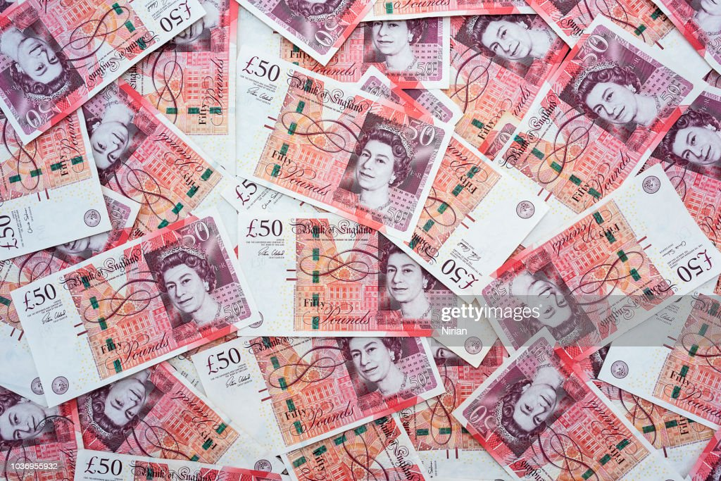 Spread of random 50 British Pound notes : Stock Photo