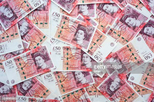 spread of random 50 british pound notes - british pound sterling note stock pictures, royalty-free photos & images