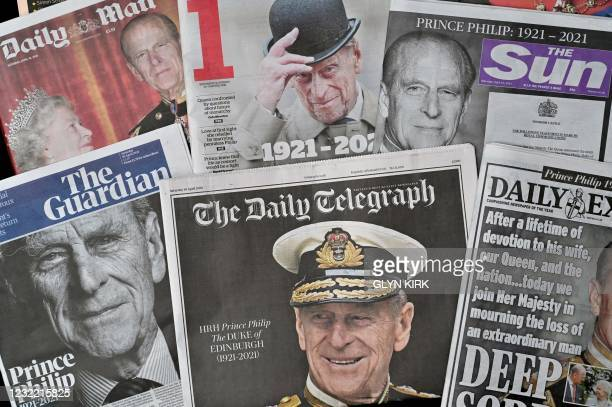 Spread shows the front pages of British newspapers reporting on the death of Britain's Prince Philip, Duke of Edinburgh, is pictured in Brighton,...