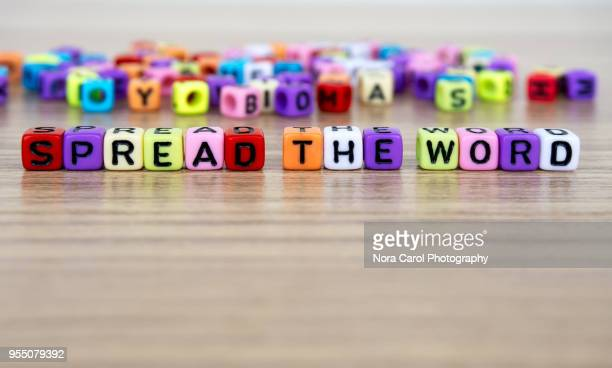 spread the word and alphabet letter beads - announcement message stock pictures, royalty-free photos & images